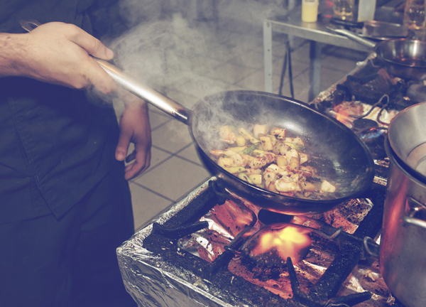 Chef is cooking seafood dish - stir fry method, toned image